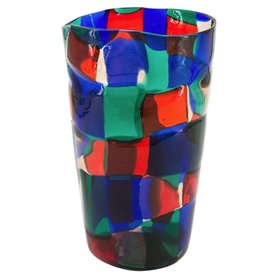 a colorful glass with a blue cup